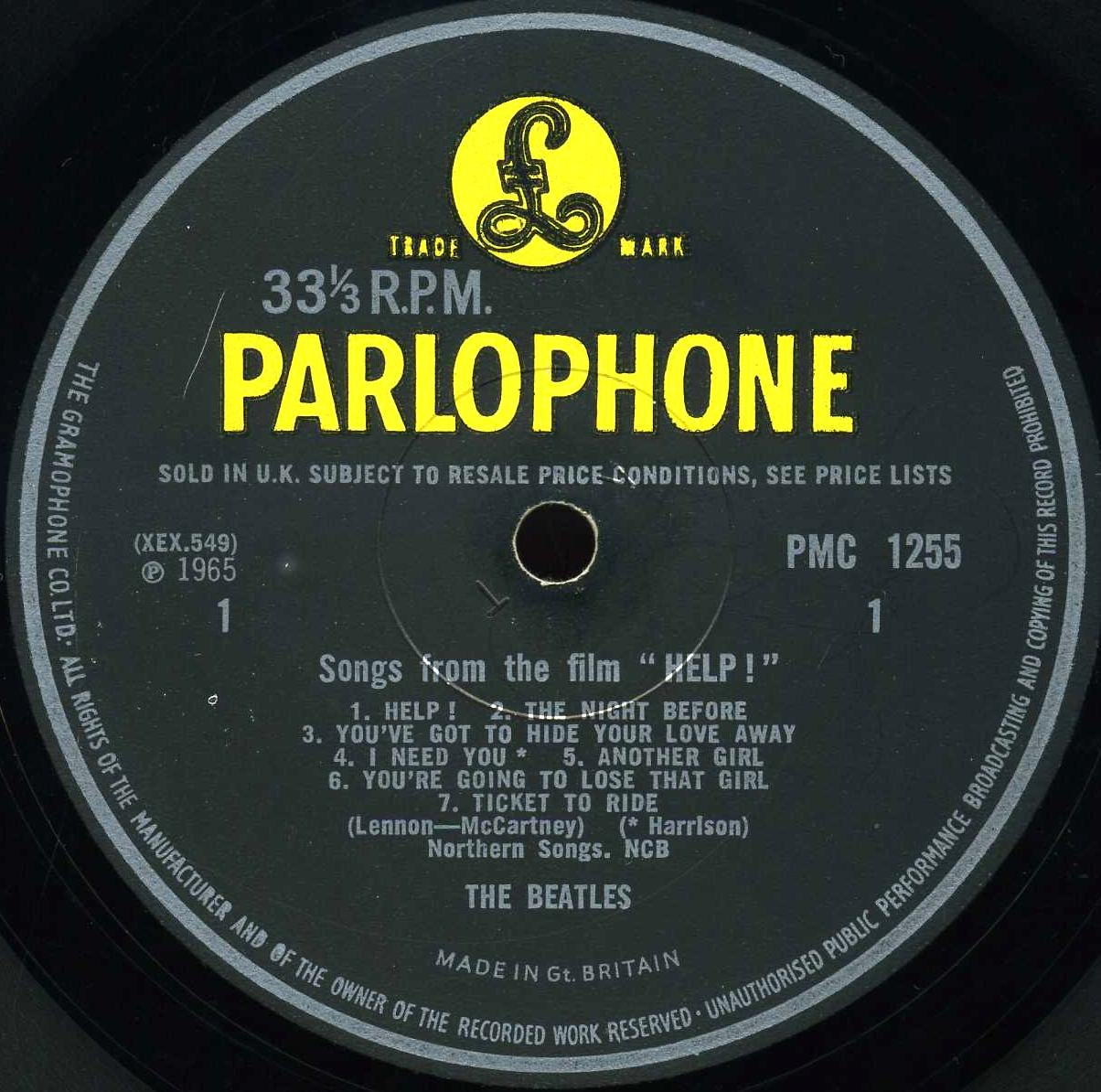 the beatles collection help parlophone pmc 1255 variation b other of the original labels used a thick font and the same credit indicator for i need you was placed to the right of the song title
