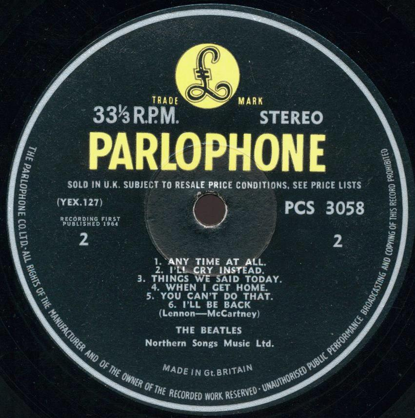 """3d6599ff Variation B. The title """"Songs from the film A Hard Day's Night"""" doesn't  take up as much width across the label as before or as it does in future."""